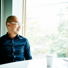 Portrait of businessman sitting in office conference room looking out window
