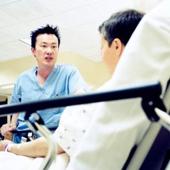 Surgeon Speaking with Patient Prior to Surgery